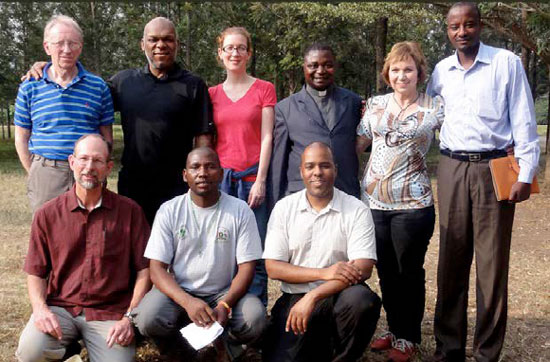 Uganda TFT team 2014, from left to right. Back row: Dr. Howard Robson, Ngub Nding, Alexandra Maillot, Fr. Peter Mbunga Basaliza, Phyll Robson, Celestin Mitabu. Front row: Roger Ludwig, Alosius, Oob Nding